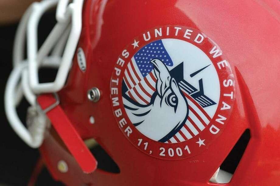 Hour Photo/Alex von Kleydorff. Detail of New Canaan High School football team helmet