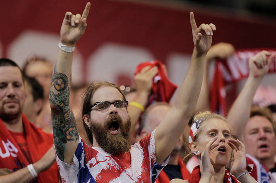 United States fans cheers on their team against Mexico during the first half of a World Cup qualifying soccer match Tuesday, Sept. 10, 2013, in Columbus, Ohio. (AP Photo/Jay LaPrete) / FR52593 AP