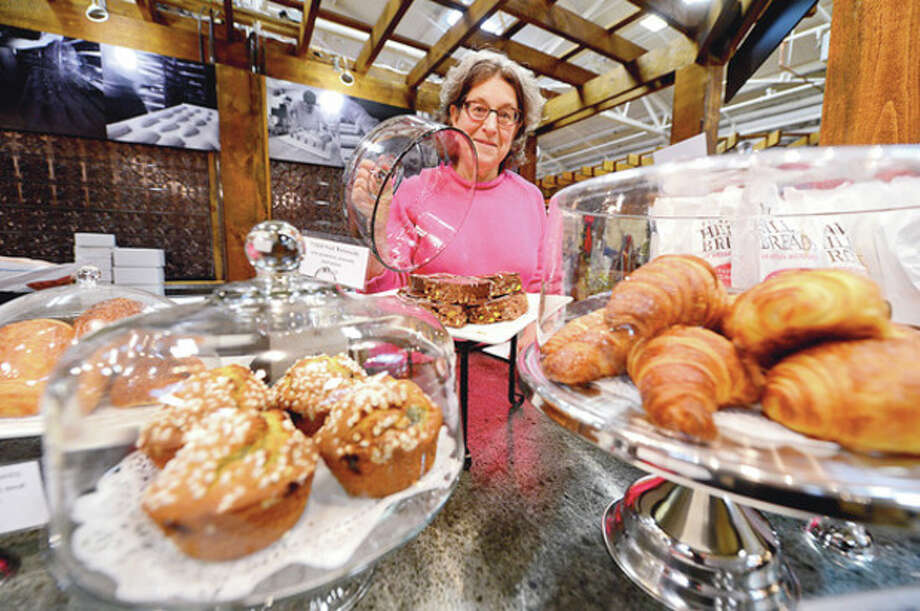Magaret Sapir of Wave Hill Breads displays her baked goods at SoNo Market. / (C)2012, The Hour Newspapers, all rights reserved