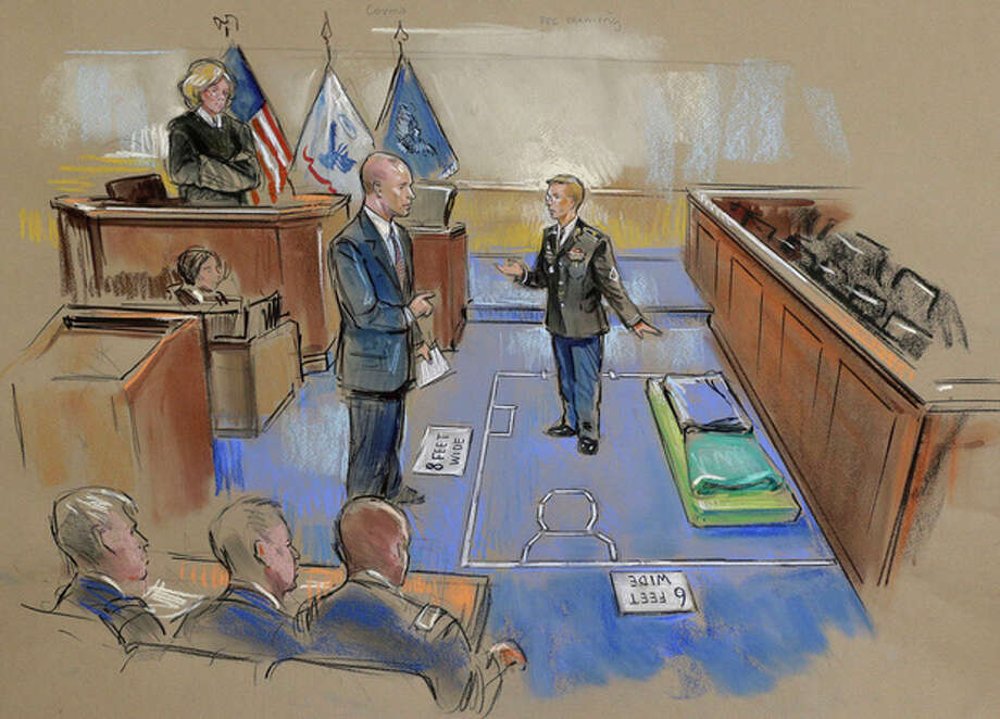 In this courtroom sketch, Army Pfc. Bradley Manning, center, describes a layout of his pretrial confinement cell in a Quantico, Va., Marine Corps brig while testifying at a pretrial hearing in Fort Meade, Md. on Thursday, Nov. 29, 2012. Military Judge, Col. Denise Lind, is at top left, and Manning's defense attorney David Coombs, is at second from left. (AP Photo/William Hennessy) NO TV, NO ARCHIVE, NO SALES, LOCALS OUT / AP