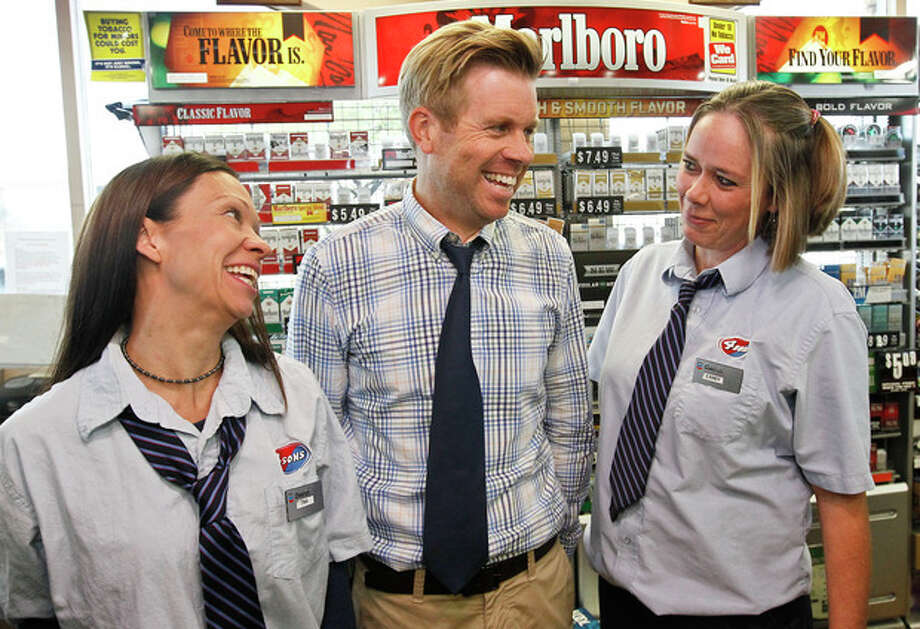 Store owner Eric Seitz, middle, laughs along with cashiers Tina Long, left, and Candy Browning at a 4 Sons Food Store where one of the winning tickets in the $579.9 million Powerball jackpot was purchased, Nov. 29, 2012, in Fountain Hills, Ariz.(AP Photo/Ross D. Franklin) / AP
