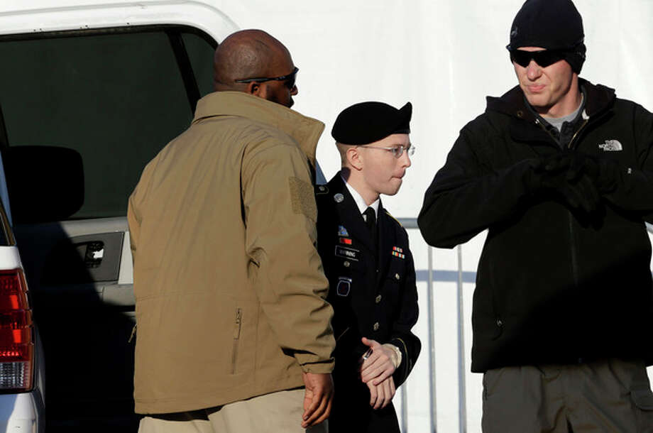 Army Pfc. Bradley Manning, second from right, steps out of a security vehicle as he is escorted into a courthouse in Fort Meade, Md., Thursday, Nov. 29, 2012, for a pretrial hearing. Manning is charged with aiding the enemy by causing hundreds of thousands of classified documents to be published on the secret-sharing website WikiLeaks. (AP Photo/Patrick Semansky) / AP
