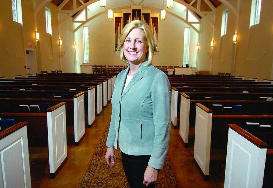 Hour Photo Alex von Kleydorff; Reverend Shannon A. White in the Wilton Presbyterian Church Sanctuary.