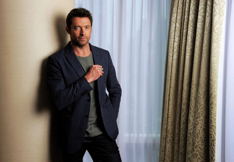 """This Sept. 7, 2013 photo shows Hugh Jackman, a cast member in the film """"Prisoners,"""" on day 3 of the 2013 Toronto International Film Festival in Toronto. (Photo by Chris Pizzello/Invision/AP) / Invision"""