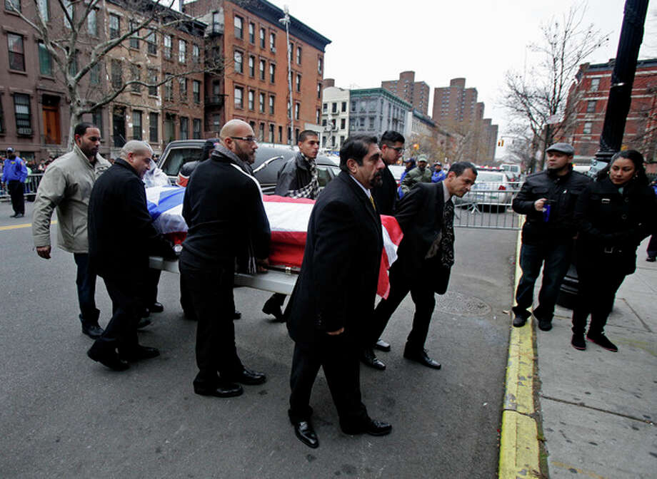 "Hector ""Macho"" Camacho's casket is brought to the steps of St. Cecilia's Roman Catholic Church in New York for a funeral, Saturday, Dec. 1, 2012. Doctors pronounced Camacho dead on Saturday, Nov. 24, after he was removed from life support at his family's direction. He never regained consciousness after at least one gunman crept up to his car in a darkened parking lot in Puerto Rico and opened fire. (AP Photo/Richard Drew) / ap"