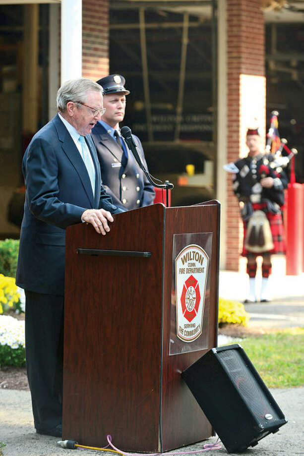 Wilton First Selectman John Brennan remarks during the Wilton 9/11 memorial ceremonies Wednesday at the Wilton Fire Department. Hour photo / Erik Trautmann