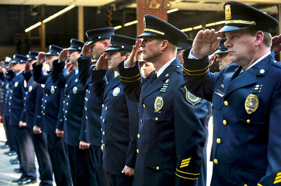 The Norwalk Police and Fire DEpartments honor those who died in the September 11th attacks during the Wilton 9/11 memorial ceremonies Wednesday at the Wilton Fire Department. Hour photo / Erik Trautmann
