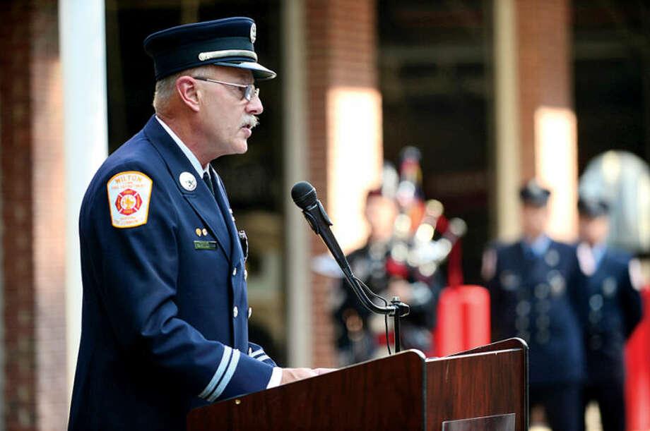 Retired Wilton Fire Department Captain Karl Dolnier remarks during the Wilton 9/11 memorial ceremonies Wednesday at the Wilton Fire Department. Hour photo / Erik Trautmann