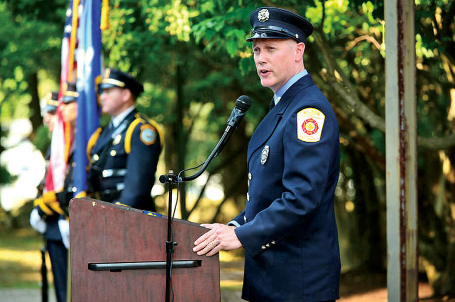 Norwalk firefighter Jim Blanchfield hosts the Wilton 9/11 memorial ceremonies Wednesday at the Wilton Fire Department. Hour photo / Erik Trautmann