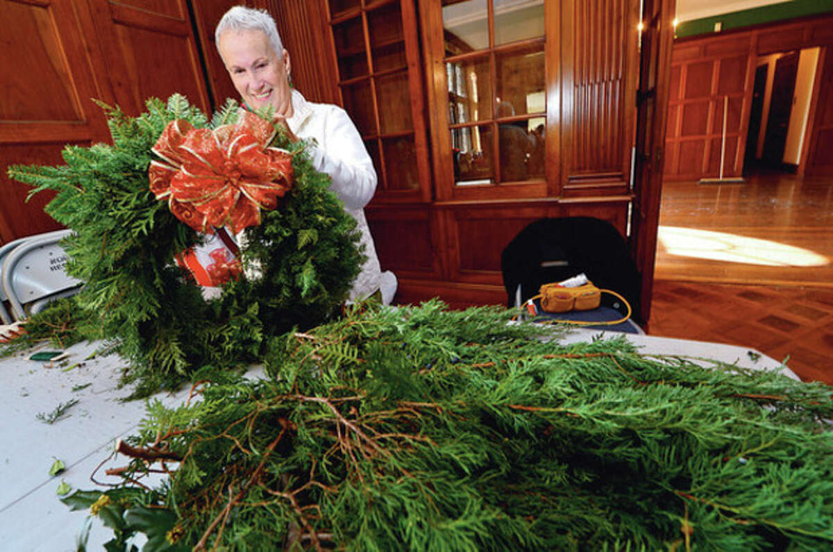 Jeanne Brown and The Norwalk Garden prepare wreaths at Gallaher Mansion for their annual Christmas Fair to be held at the Cranbury Chapel Saturday. Hour photo / Erik Trautmann