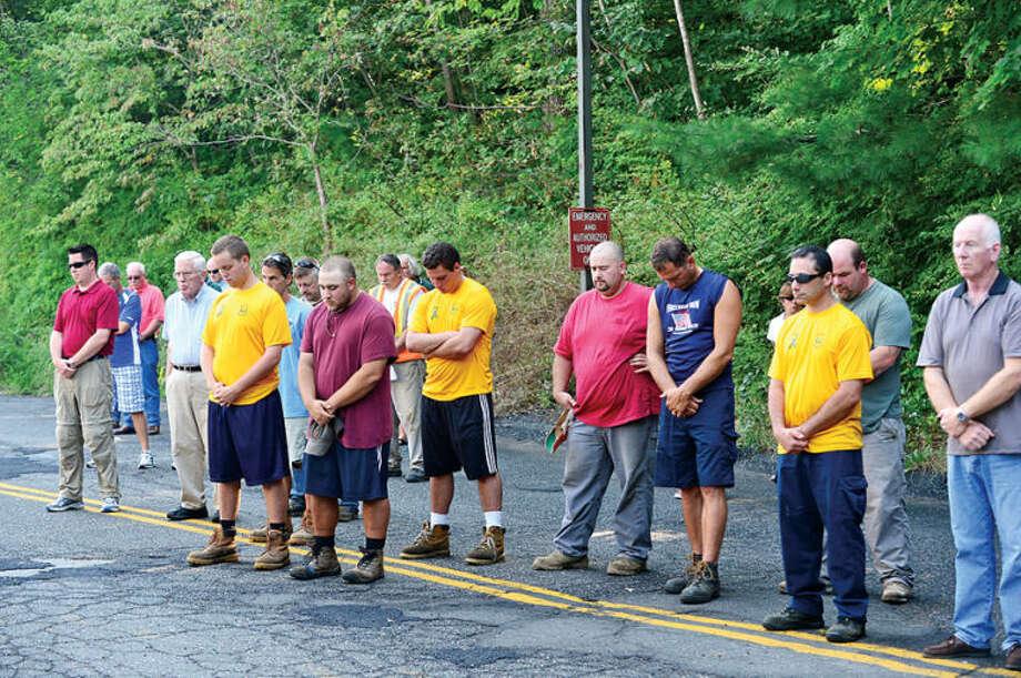 Wilton residents and town employees gather for the Wilton 9/11 memorial ceremonies Wednesday at the Wilton Fire Department. Hour photo / Erik Trautmann