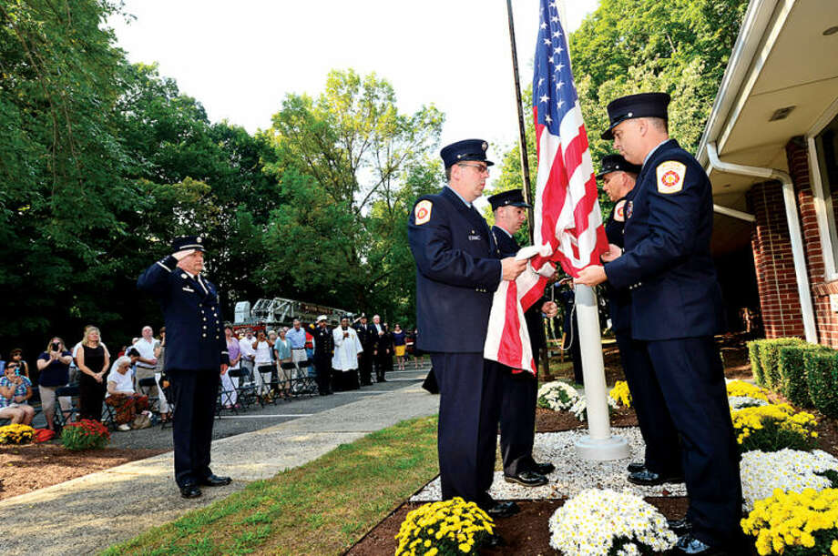 The Wilton Fire Department pots the colors during the Wilton 9/11 memorial ceremonies Wednesday at the Wilton Fire Department. Hour photo / Erik Trautmann