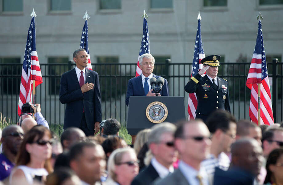 From left, President Barack Obama, Defense Secretary Chuck Hagel and Joint Chiefs Chairman Gen. Martin Dempsey, pay their respects to the victims of the Sept 11 attacks during a remembrance ceremony at the Pentagon, Wednesday, Sept. 11, 2013. (AP Photo/Manuel Balce Ceneta) / AP