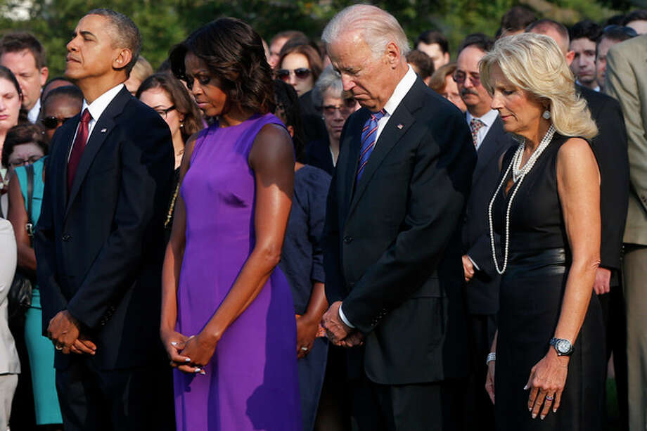 President Barack Obama, first lady Michelle Obama, Vice President Joe Biden, and Jill Biden stand for a moment of silence on the South Lawn of the White House in Washington, Wednesday, Sept. 11, 2013, to mark the 12th anniversary of the September 11 terror attacks. (AP Photo/Charles Dharapak) / AP