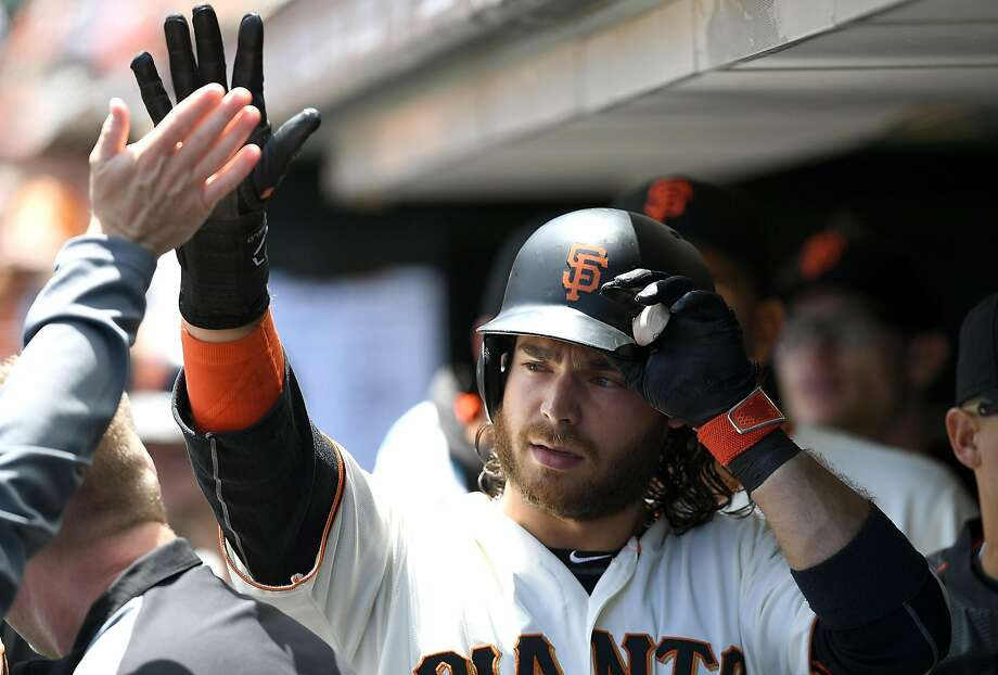 SAN FRANCISCO, CA - JUNE 15:  Brandon Crawford #35 of the San Francisco Giants is congratulated by teammates after he scored against the Milwaukee Brewers in the bottom of the third inning at AT&T Park on June 15, 2016 in San Francisco, California.  (Photo by Thearon W. Henderson/Getty Images) Photo: Thearon W. Henderson, Getty Images