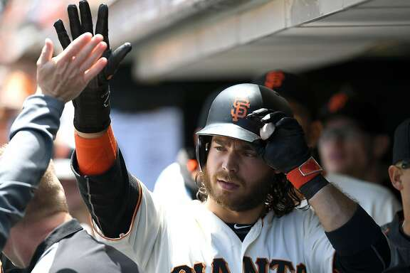 SAN FRANCISCO, CA - JUNE 15:  Brandon Crawford #35 of the San Francisco Giants is congratulated by teammates after he scored against the Milwaukee Brewers in the bottom of the third inning at AT&T Park on June 15, 2016 in San Francisco, California.  (Photo by Thearon W. Henderson/Getty Images)