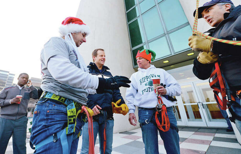 New York Yankees General manger Brian Cashman and sports great Bobby Valentine rappel from Stamford's 1 Landmark Square building Friday in preparation for Sunday nights Christmas tree lighting.Hour photo / Erik Trautmann / (C)2012, The Hour Newspapers, all rights reserved