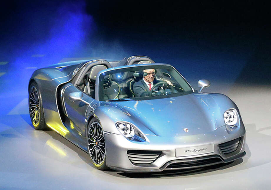 Porsche AG CEO Matthias Mueller steers the new Porsche 918 Spyder during a preview by the Volkswagen Group prior to the 65th Frankfurt Auto Show in Frankfurt, Germany, Monday, Sept. 9, 2013. More than 1,000 exhibitors will show their products to the public from Sept. 12 through Sept. 22, 2013. (AP Photo/Frank Augstein) / AP
