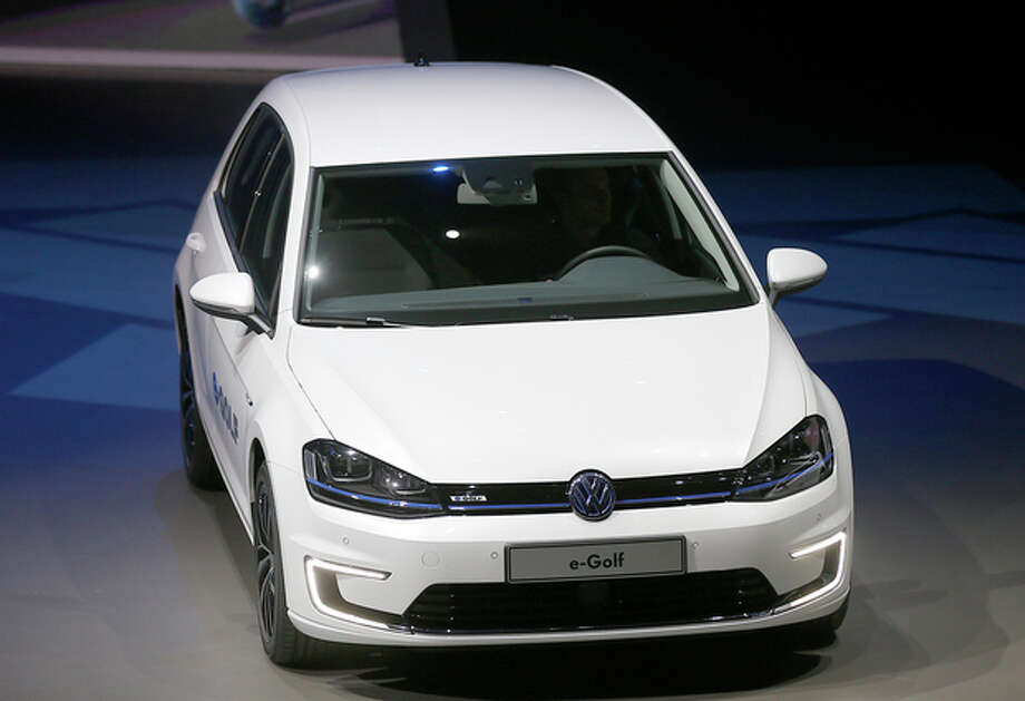 The new Volkswagen e-Golf displayed during a preview by the Volkswagen Group prior to the 65th Frankfurt Auto Show in Frankfurt, Germany, Monday, Sept. 9, 2013. More than 1,000 exhibitors will show their products to the public from Sept. 12 through Sept. 22, 2013. (AP Photo/Frank Augstein) / AP