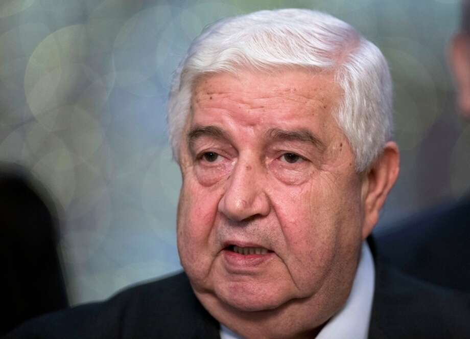 """Syrian Foreign Minister Walid al-Moallem speaks to the media in Moscow, Monday, Sept. 9, 2013. Syria's foreign minister said his country welcomes Russia's proposal for it to place its chemical weapons under international control and then dismantle them quickly to avert U.S. strikes. Moallem's statement came hours after U.S. Secretary of State John Kerry said Assad could resolve the crisis surrounding the alleged use of chemical weapons by his forces by surrendering control of """"every single bit"""" of his arsenal to the international community by the end of the week. (AP Photo/Alexander Zemlianichenko) / AP"""