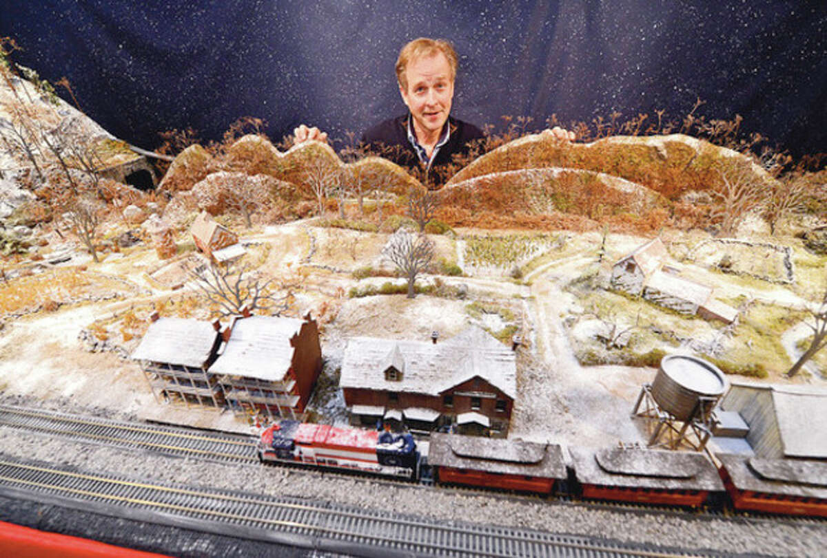 The Rowayton Historical Society exhibits a model a train display by Brian Kammerer at Pinkney house in advance of Light Up Rowayton Sunday evening. Hour photo / Erik Trautmann