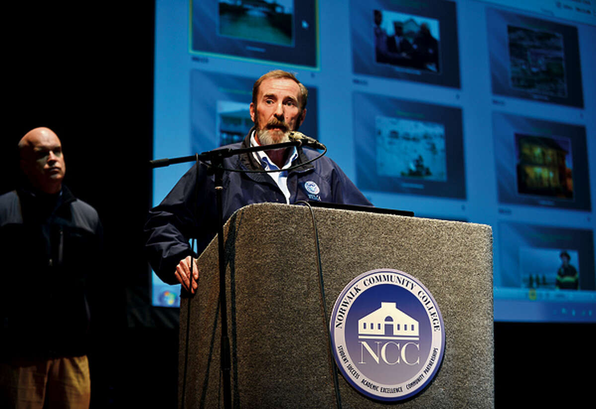 FEMA representative Gary Stanley speaks at an informational session held by Congressman Jim Himes (CT-4) and representatives from the Federal Emergency Management Agency (FEMA) and the Small Business Administration (SBA) which outlined their services for those affected by Hurricane Sandy at Norwalk Community College Satuday. Hour photo / Erik Trautmann