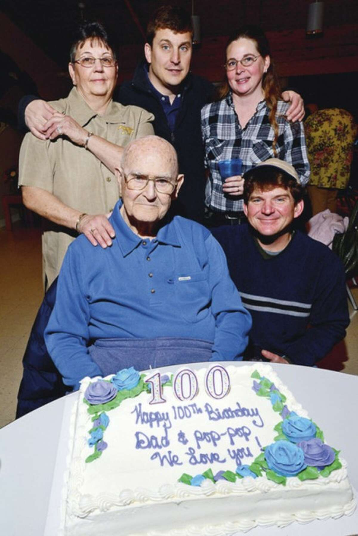 Former Hour employee Stanley Wilmott turns 100 and has a family reunion party with daughter Suellen Lee and grandchilden, Kevin Yates, Tracey Francisco and Breen Yates as well at Ogden House in Wilton Saturday. Hour photo / Erik Trautmann
