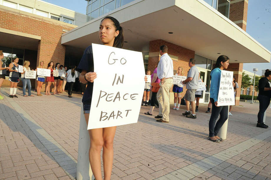 Hour photo / Matthew VinciFreni Campos, with other members of the Center for Youth Leadership at Brien McMahon High School, holds an anti-bullying sign during a vigil Tuesday for Bart Palosz.