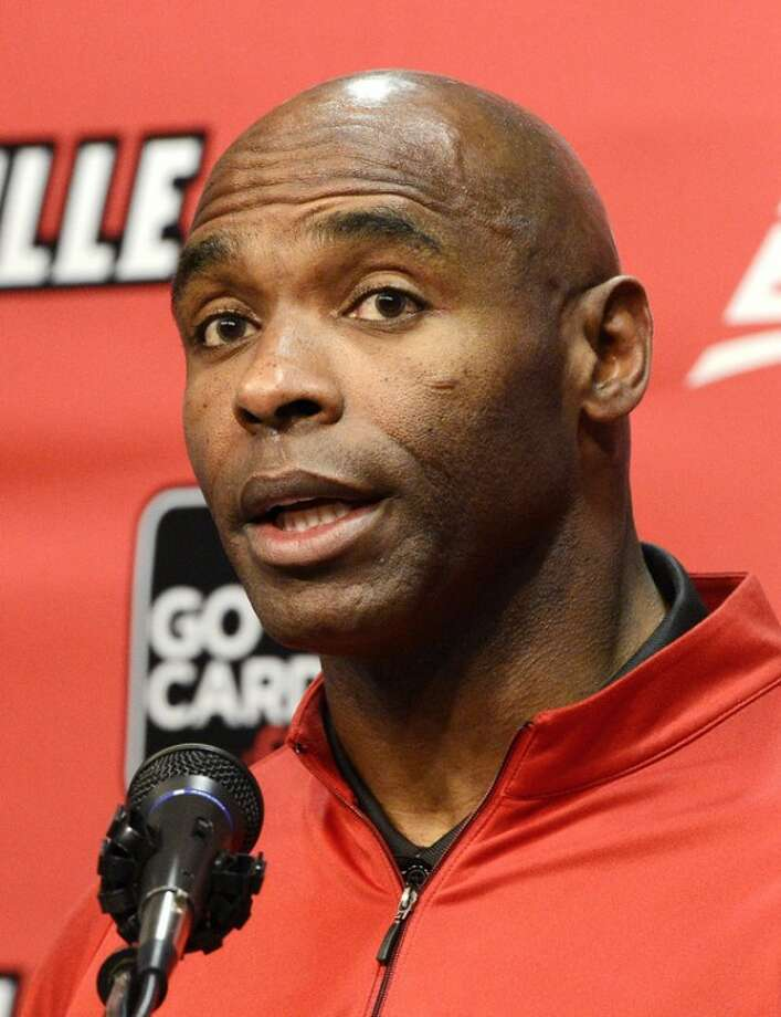 Louisville head football coach Charlie Strong answers a reporters question during a press conference Thursday, Dec. 6, 2012, in Louisville, Ky. Strong announced this morning that he has turned down the head coaching job offer from the University of Tennessee and will stay at Louisville. (AP Photo/Timothy D. Easley)