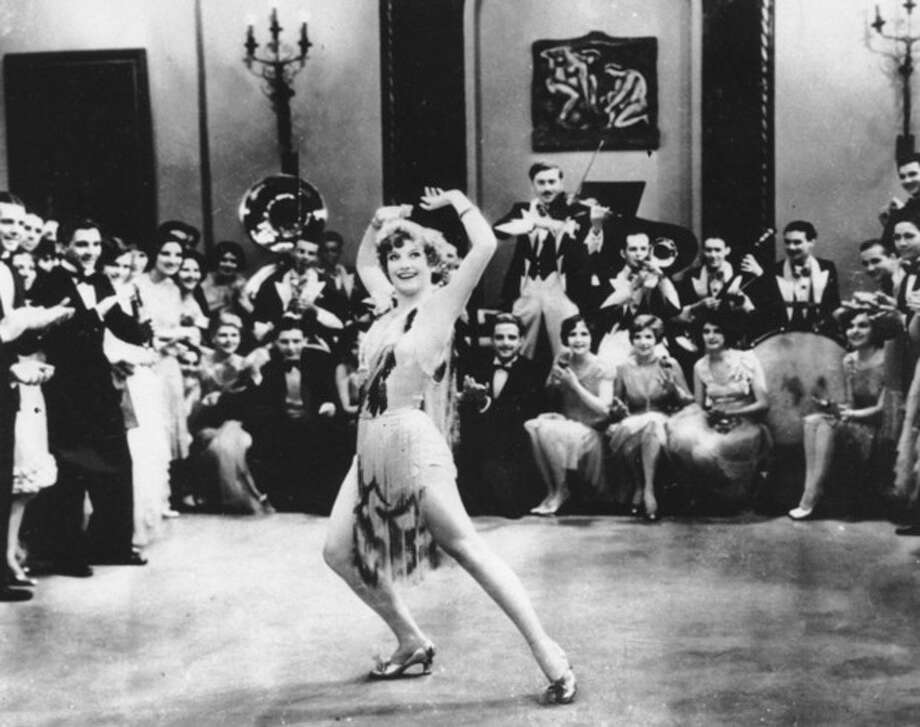 """FILE - In this 1928 file photo, Actress Joan Crawford is seen dancing the Charleston in """"Our Dancing Daughters"""" in Hollywood, Calif. A report released, September, 10, 2013, shows that the very wealthiest Americans earned more than 19 percent of the country's household income in 2012, their biggest share since 1928. And the top 10 percent captured a record 48.2 percent of total earnings last year. (AP Photo/File) / AP"""
