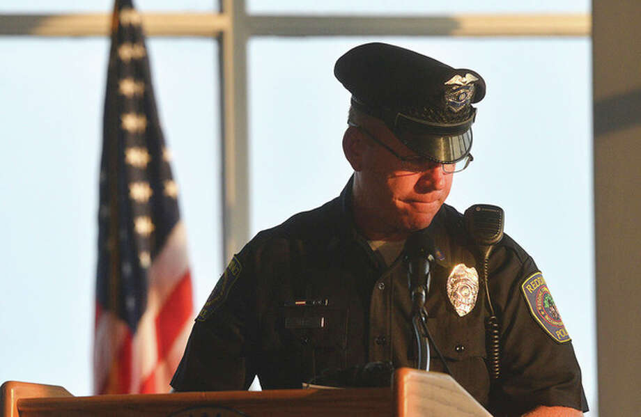 Hour Photo/Alex von Kleydorff Redding police officer Chris Vadas reads just some of the many names of Connecticut's 9-11 victims