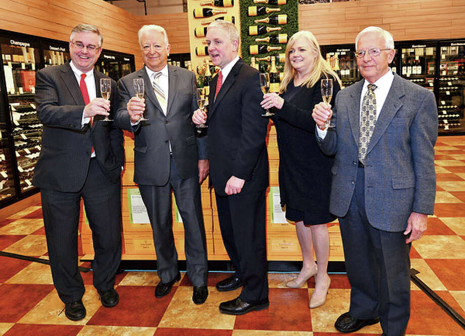 Total Wine co owner David Trone, Norwalk Mayor Richard Moccia, Total Wine co owner Robert Trone, Food Bank Executive Director Kate Lombardo and Food Bank Board Chair Sam Cingari toast the grand opening of Total Wine on Main Ave in Norwalk Thursday afternoon. / ©2012 The Hour Newspapers