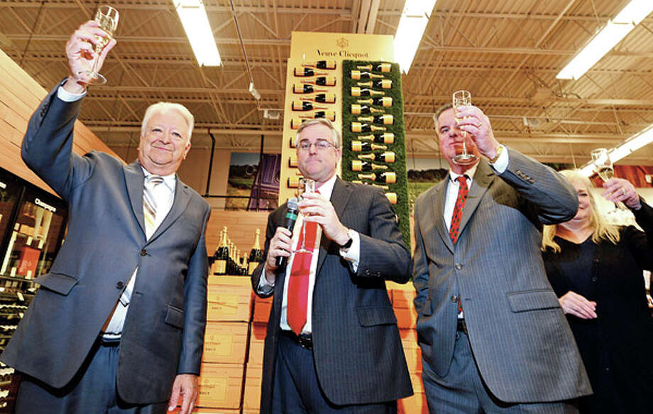 Norwalk Mayor toasts with Total Wine co owner David and Robert Trone a the grand opening of Total Wine on Main Ave in Norwalk Thursday afternoon. / ©2012 The Hour Newspapers