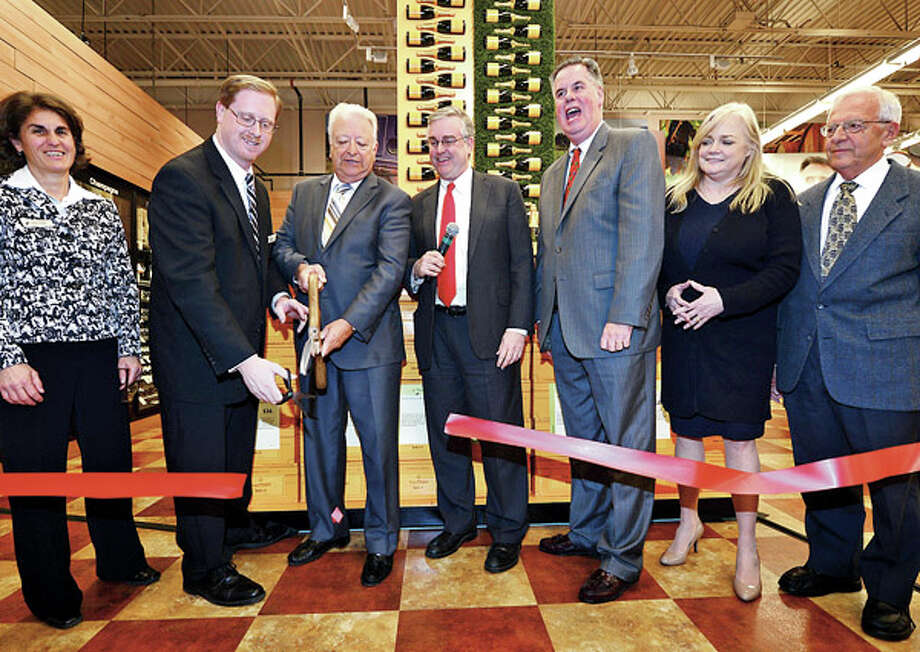 Total Wine Area Vice President Sandy Clemens, Store Manager Tom Perry, owner David Trone Norwalk Mayor Richard Moccia, Chamber of Commerce President Ed Musante, Food Bank Executive Director Kate Lombardo and Food Bank Board Chair Sam Cingari help cut the ribbon at the grand opening of Total Wine on Main Ave in Norwalk Thursday afternoon. / ©2012 The Hour Newspapers