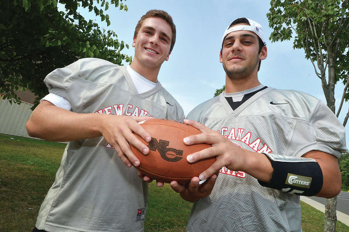Hour Photo/Alex von Kleydorff Ted Bossidy, left, and Nick Cascione share quarterback duties for the New Canaan football team, and so far it's been a recipe of success for the Rams.