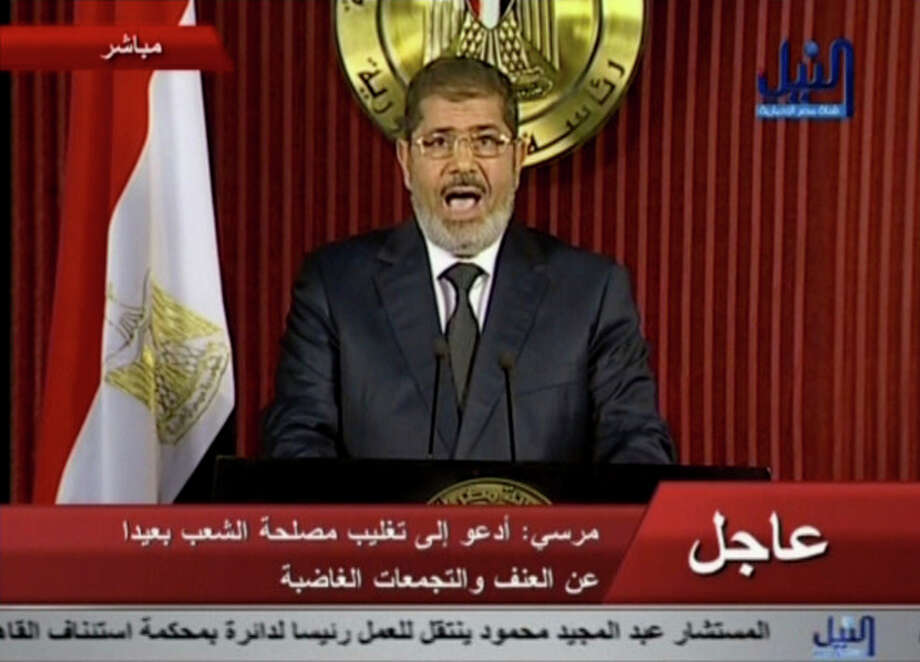 In this image made from video, Egyptian President Mohammed Morsi delivers a televised statement in Cairo, Egypt, Thursday, Dec. 6, 2012. (AP Photo/Nile TV) EGYPT OUT / EGYPT OUT