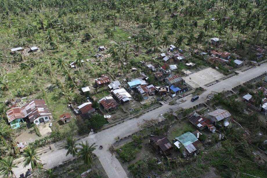 In this photo released by the Philippine Army 10th Infantry Division shows an aerial view of toppled trees and homes caused by flashfloods in Compostela Valley province, southern Philippines on Thursday Dec. 6, 2012. The powerful typhoon that washed away emergency shelters, a military camp and possibly entire families in the southern Philippines has killed hundreds of people with nearly 400 missing, authorities said Thursday. (AP Photo/ Philippine Army 10th ID) / Philippine Army 10th ID