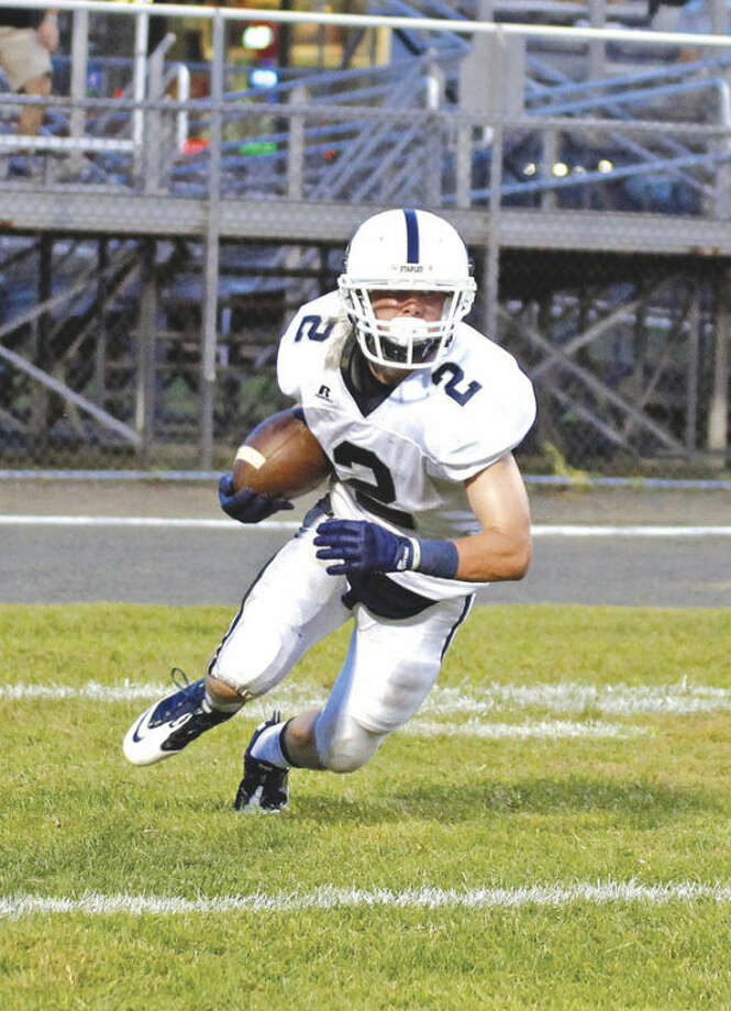 Hour photo/Danielle CallowayStaples wideout Will Johnson makes a play during the season's kick-off game against Xavier at Palmer Field in Middletown on Wednesday. The host Falcons held on for a 30-22 victory over the Wreckers.