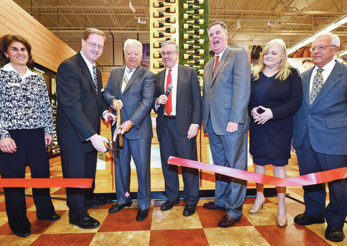 Total Wine Area Vice President Sandy Clemens, Store Manager Tom Perry, owner David Trone Norwalk Mayor Richard Moccia, Chamber of Commerce President Ed Musante, Food Bank Executive Director Kate Lombardo and Food Bank Board Chair Sam Cingari help cut the ribbon at the grand opening of Total Wine on Main Ave in Norwalk Thursday afternoon.