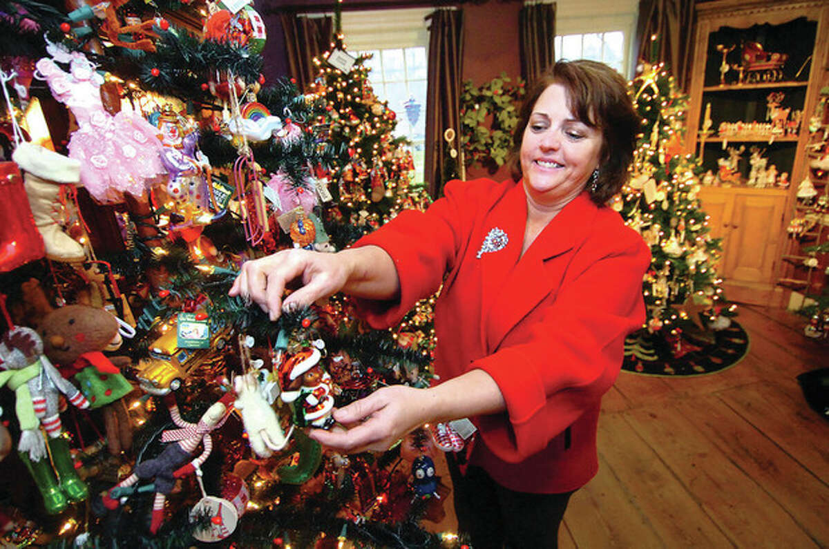 Hour Photo/Alex von Kleydorff. Jennifer Gish makes sure the kids tree has ornaments on every branch at The Historical Christmas Barn at Lambert House in Wilton. With almost 2 dozen themed trees there is an ornamnet for everyone and after moving into their new space at Lambert House in the same 150 Danbury Rd complex they have expanded their collection of all things Chrsitmas from all over the world.