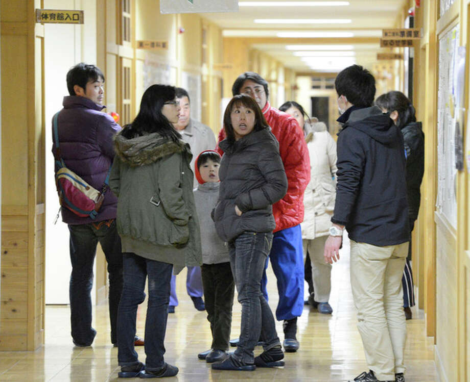 Tsunami evacuees arrive at Takata Junior High School that stands on a higher ground in Rikuzentakata in Iwate Prefecture, Friday, Dec. 7, 2012 after a tsunami warning has been issued following a strong earthquake that struck off the coast of northeastern Japan. It is the same region that was hit by a massive earthquake and tsunami last year. (AP Photo/Kyodo News) JAPAN OUT, MANDATORY CREDIT, NO LICENSING IN CHINA, FRANCE, HONG KONG, JAPAN AND SOUTH KOREA / Kyodo News