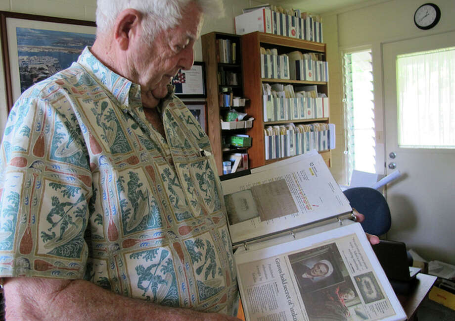 Ray Emory discusses his work pushing to change grave markers for unknown Pearl Harbor dead and identifying the remains of unknowns at his home in Honolulu on Nov. 21, 2012. The Navy and National Park Service will honor Emory on Dec. 7 for his determination to have Pearl Harbor remembered, and remembered accurately.(AP Photo/Audrey McAvoy) / AP