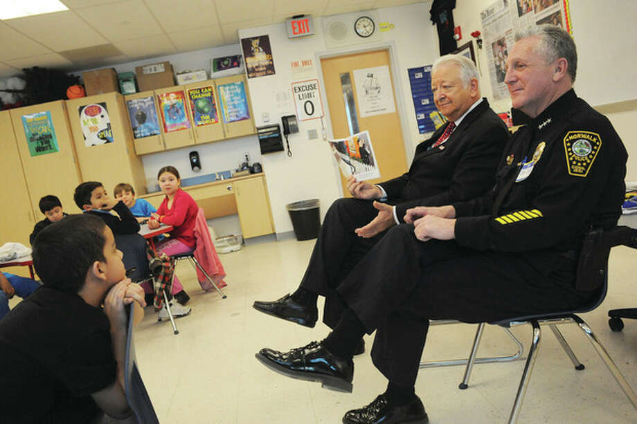 Norwalk Mayor Richard Moccia and Police Chief Harry Rilling read to 3rd graders at Brookside School Friday for the Read Across America Day. hour photo/matthew vinci