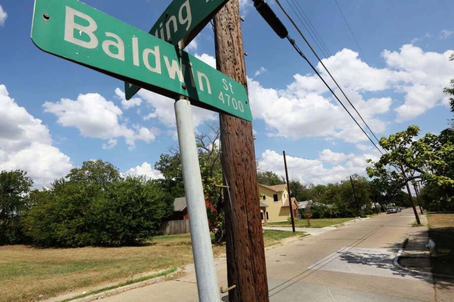 This photo shows Baldwin Street, where rape suspect Van Dralan Dixson has a home, on Monday, Sept. 9, 2013, in Dallas. Dallas police are searching for rape suspect Van Dralan Dixson, a crime watch volunteer, who has been charged with one count of aggravated sexual assault in connection to a rape and robbery in Fair Park. (AP Photo/LM Otero) / AP