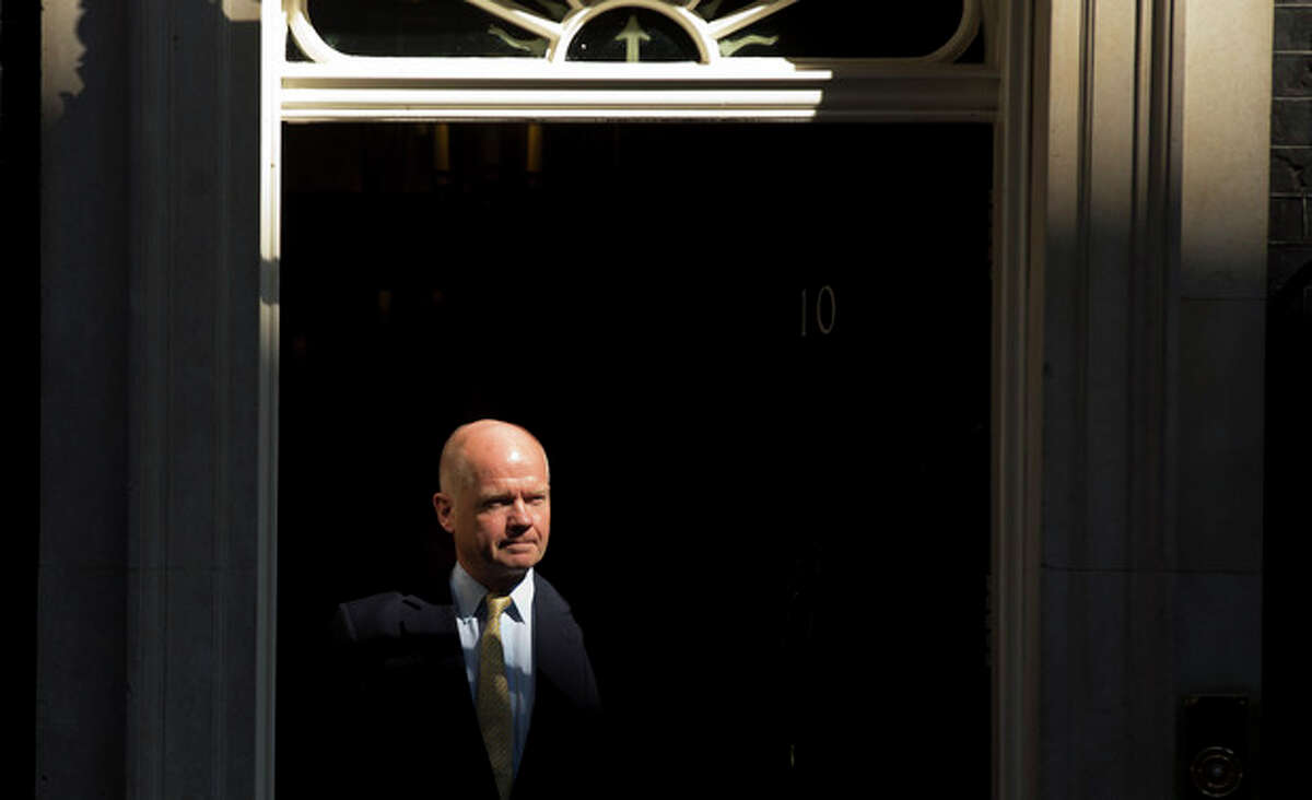 British Foreign Secretary William Hague leaves 10 Downing Street in London, after attending a cabinet meeting on Syria, Thursday, Aug. 29, 2013. Britain's opposition Labour Party has indicated it may not support even a watered down version of a government resolution on Syria. Labour leader Ed Miliband said Thursday he is unwilling to give Prime Minister David Cameron a