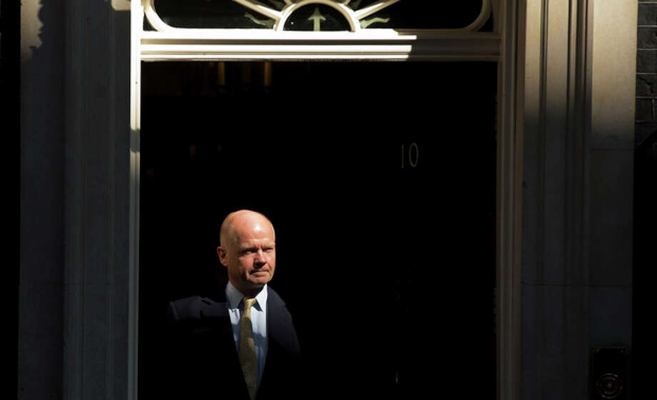 "British Foreign Secretary William Hague leaves 10 Downing Street in London, after attending a cabinet meeting on Syria, Thursday, Aug. 29, 2013. Britain's opposition Labour Party has indicated it may not support even a watered down version of a government resolution on Syria. Labour leader Ed Miliband said Thursday he is unwilling to give Prime Minister David Cameron a ""blank check"" for conducting possible future military operations against Syria. (AP Photo/Matt Dunham) / AP"