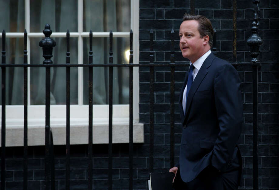 "Britain's Prime Minister David Cameron leaves 10 Downing Street in London, to be driven to the Houses of Parliament for a debate and vote on Syria, Thursday, Aug. 29, 2013. Britain's opposition Labour Party has indicated it may not support even a watered down version of a government resolution on Syria. Labour leader Ed Miliband said Thursday he is unwilling to give Prime Minister David Cameron a ""blank check"" for conducting possible future military operations against Syria. (AP Photo/Matt Dunham) / AP"
