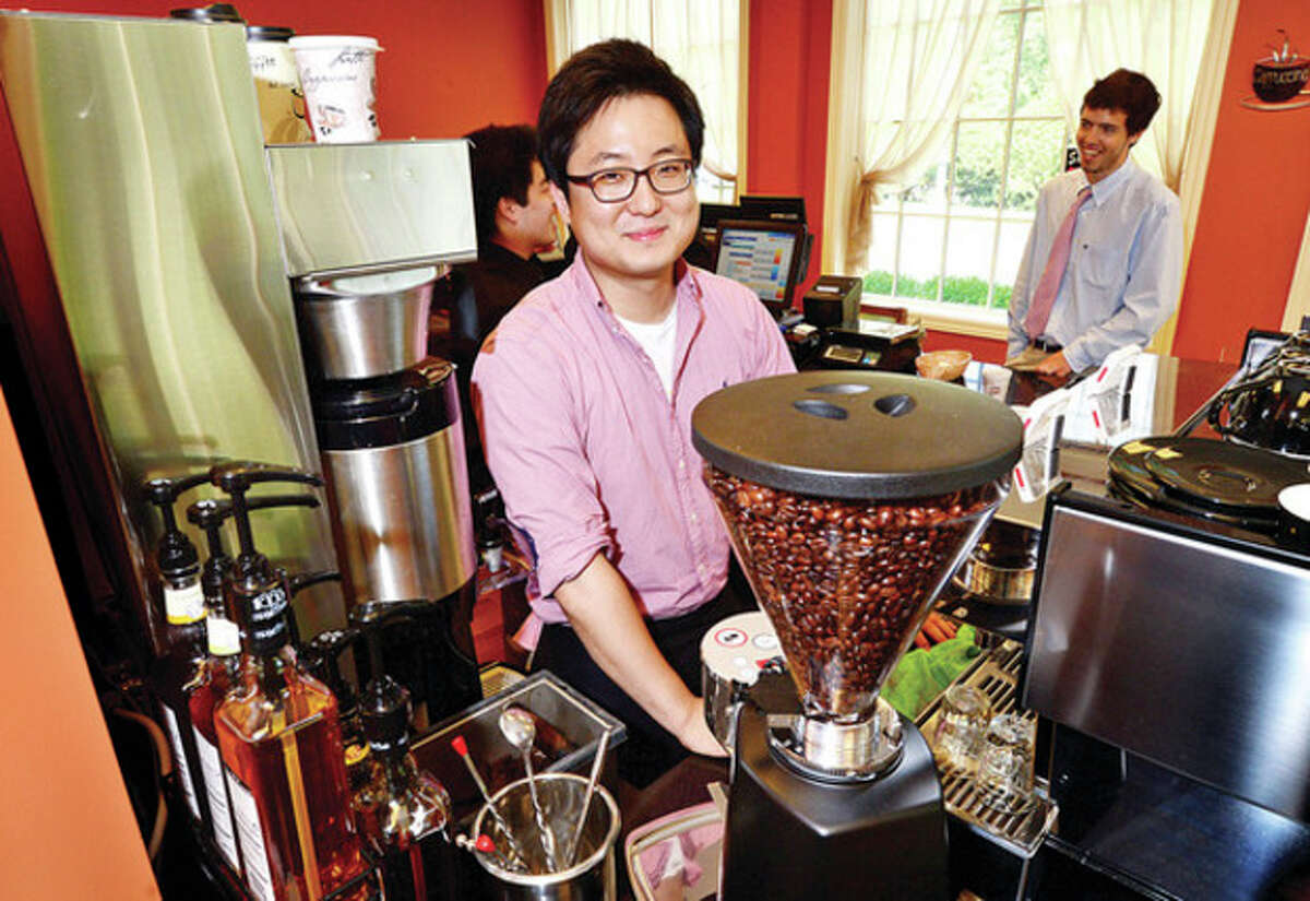 Han Lee, the owner of Coffee Story, a new cafe that opened its doors on Monday in Wilton. Coffee Story serves gourmet coffee, self-serve frozen yogurt, smoothies, juices and baked goods. Hour photo / Erik Trautmann