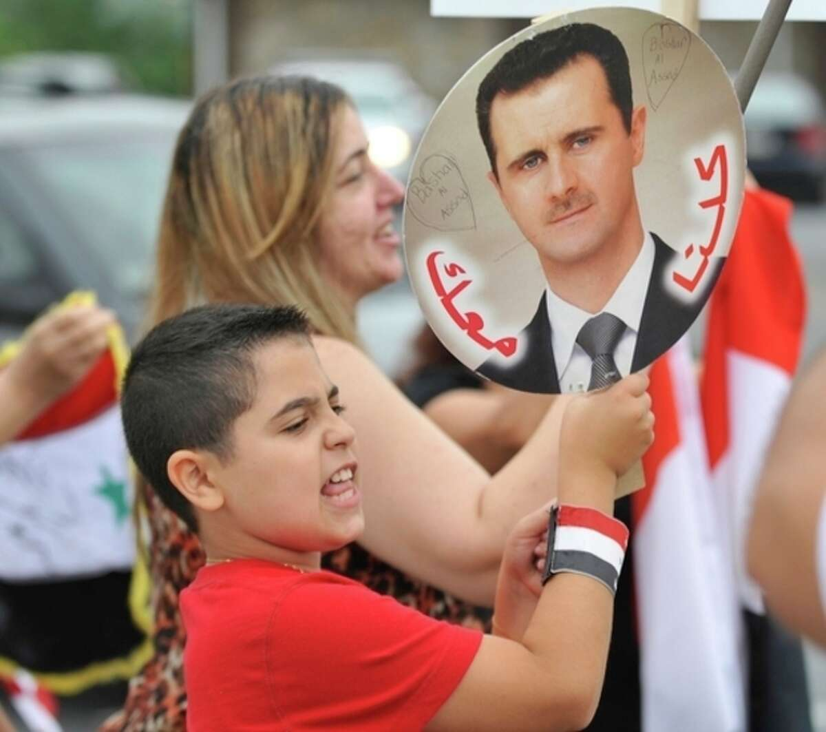 Members of the local Syrian community rally for the second day in a row against the United States' involvement in Syria, Wednesday, Aug. 28, 2013 in Allentown, Pa. President Barack Obama on Wednesday declared unequivocally that the United States has