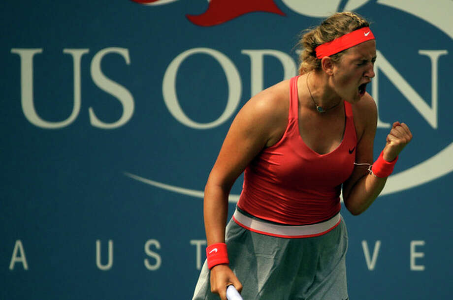Victoria Azarenka, of Belarus, reacts after a shot to Alize Cornet, of France, during the third round of the 2013 U.S. Open tennis tournament, Saturday, Aug. 31, 2013, in New York. (AP Photo/David Goldman) / AP